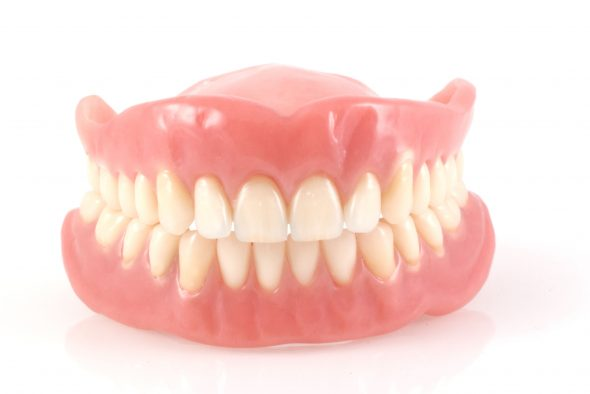 Dentures fake teeth isolated on a white background.